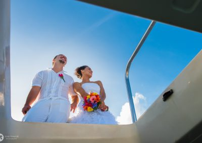 Bride and groom at the top of the yacht